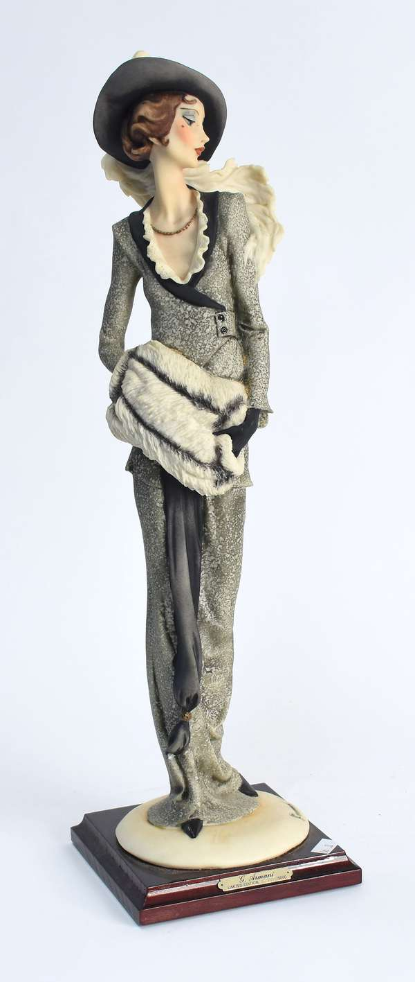 "G. Armani sculpture of a fashion girl,  17""H. (66-3)"