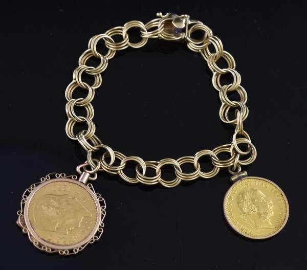 14k gold charm bracelet set with 2 gold coins, 24 grams (105-10)