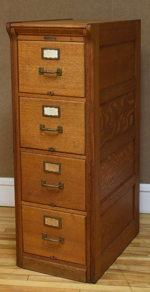 "Antique oak four drawer file cabinet, by Yawman and Erbe Mfg. Co., Rochester NY, 17.5""W x 53""H x 28.5""D (133-8)"