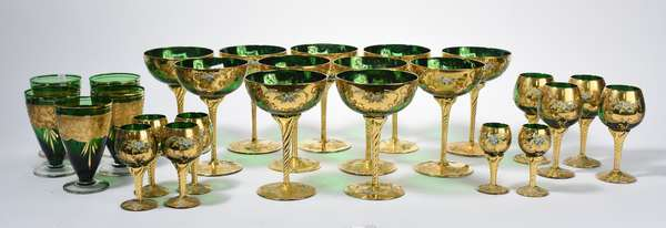 Large set of Moser/Viennese green and gilded glass stemware, including goblets, small wines, sherrys, etc., 27 pieces (105-15)