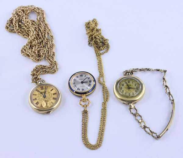Two lady's pocket watches on Gruen in 14K gold both with gold filled chains along with a gold filled watch (81-20)