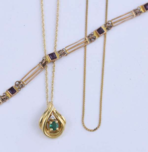 14K gold necklace and pendant set with a diamond and emerald, plus a small 14k gold chain all weighing 4.4 grams, along with a 10K bracelet weighing 2.3 grams (81-26)