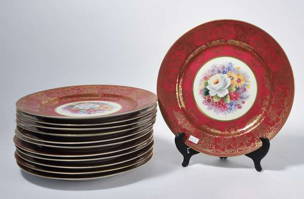"Set of 12 hand painted dinner plates, red and gilded border with floral center, 11""Dia. (105-17)"
