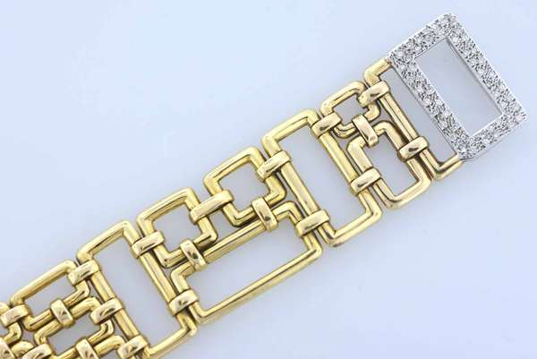 "18K gold diamond bracelet, linked Mid Century Frank Lloyd Wright design, end link set with approx. 50 full cut diamonds, .03 CT each, approx. 1 plus cwt. VS-SI, H-I color, size 7.5""L x 1 and 3/8th"" wide, weighing 90 grams. Condition: very good with no damage or loss, preowned but gently used."