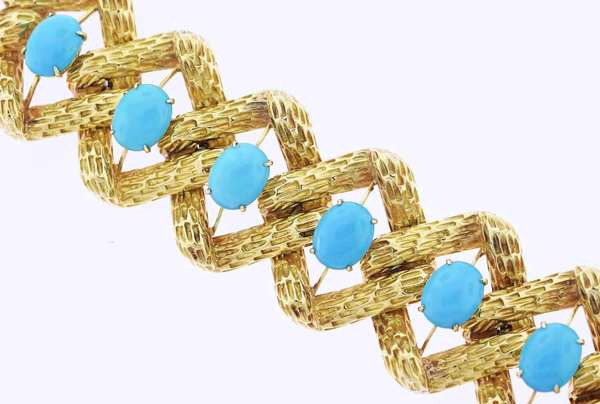 "Exceptional 18k gold turquoise bracelet, with interlocking square links with deep bamboo textured design, each link set with an oval powder blue turquoise stone each measuring approx. 12.1mm x 15.2mm, size of bracelet 7""L x 1.75""W, 172 grams. Condition: excellent no damage or loss, claps mechanism works well."