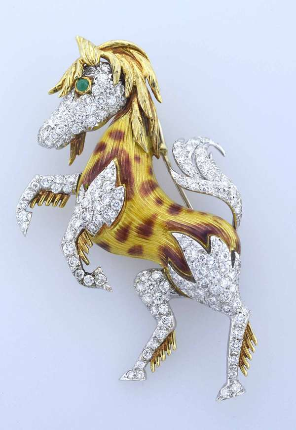 "Enamel ""mustang"" horse pin in eighteen karat yellow and white gold set with approximately 4.0 ct. tw. round brilliant cut diamonds, G-H color, VS-SI clarity, very good cut, accented by an medium green emerald cabochon eye, 2.5 mm, .05 ct. 2 ¾ inches long by 1 ½ inches wide. 27.3 grams. Condition: excellent"