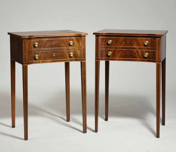 "Pair of Stickley Colonial Williamsburg Reserve Collection two-drawer stands in mahogany, with concave fronts and light-colored wood inlay. On tapered legs, stamped and labeled on interior of upper drawer. 19""L x 14.5""W x 28.75""H. Condition: some finish wear to tops, drawers slide smoothly."