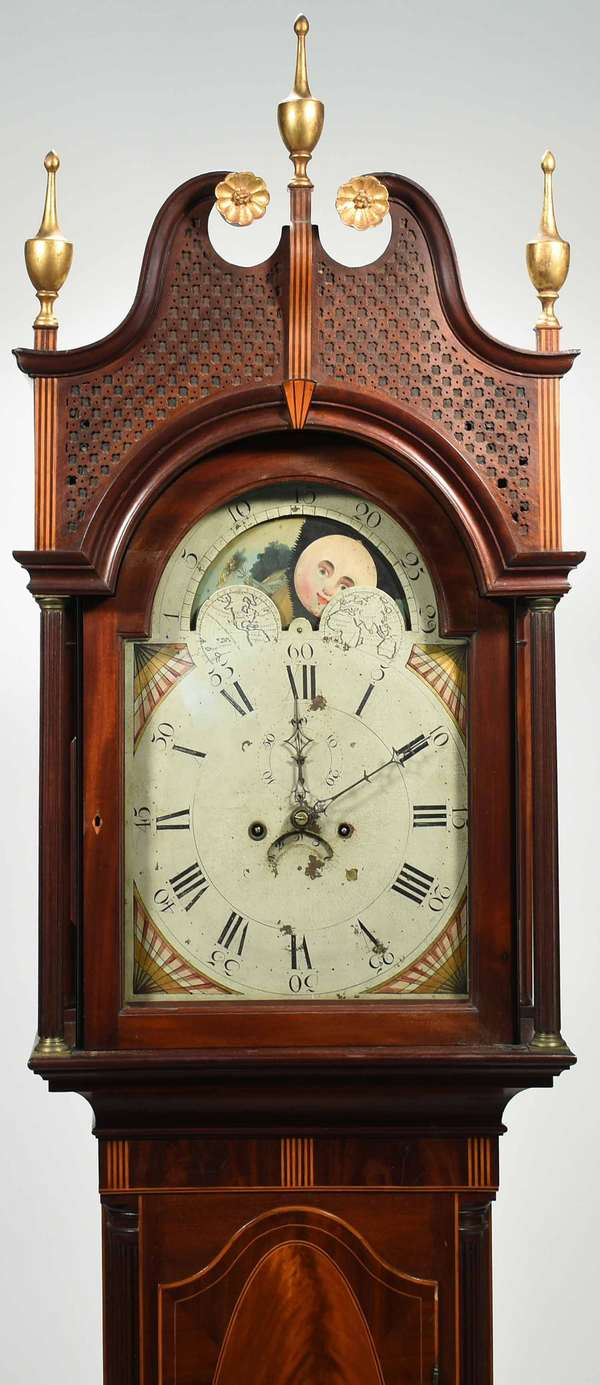 "Fine Matthew Egerton Federal Tall clock, bonnet with signature star punch motif, three gilded finials, stripe inlay, and gilded rosettes. Case with corner columns, banded and other geometric inlay. Hand painted moon phase dial. Original label on inside of door reading ""Matthew Egerton Cabinetmaker, in Burnett St, New Brunswick N.J."". with weights, pendulum, key and winding key. 95""H, bonnet 19.5""W x 10.5""D. Condition: the case is in very good original condition with the exception of old repair work done to the feet, patch to swans neck back facing original, pierced bonnet backed with fabric some holes however wood work not damaged, dial of clock with some flaking but original paint, works restored in 2007 by The British Clockmaker, VT, see paperwork."