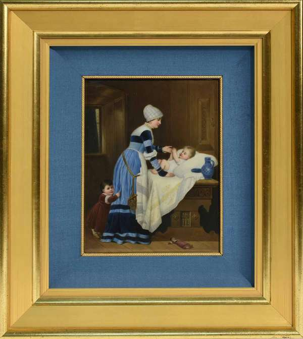 "Framed KPM plaque, mother in blue dress, with two children. Stamped KPM on back. Framed with blue matting in a gilded frame. Sight size: 11"" x 8.5"". Frame: 21"" x 18.5"". 8.5 lbs. Condition: not examined out of frame. One or two light scratches to surface, overall very good."