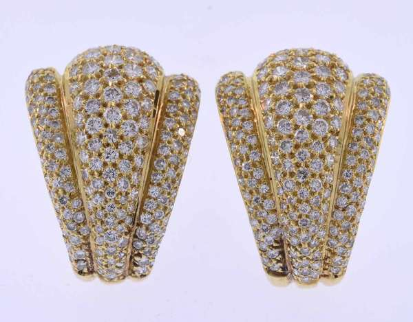 Eighteen karat yellow gold post earrings with omega clips set with approximately 5.0 ct. tw. round brilliant cut diamonds, G-H color, VS-SI clarity, very good cut. 7/8 inches wide at the top and 1 ¼ inch long. 19.7 grams. Very good condition.