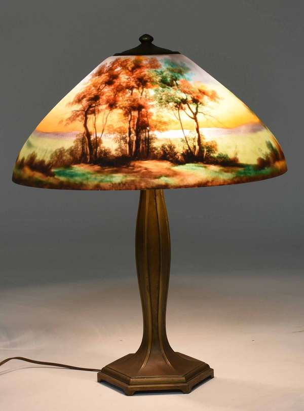 "Jefferson reverse painted table lamp with fluted bronze base, and hand-painted pastoral shade dated 1876. Shade stamped ""Jefferson"" on top bronze collar, two sockets. Shade 18"" dia. x 24""H. 13.5 lbs. Condition: good with no damage estate as found"