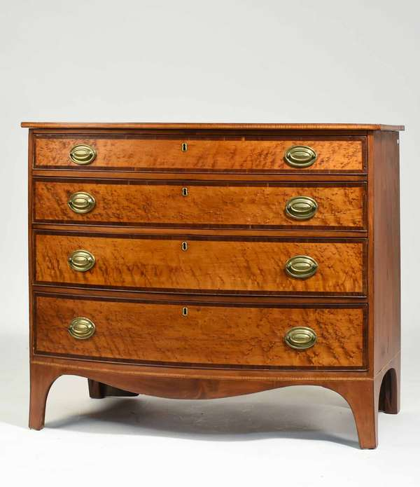 "Fine Federal bow front chest in mahogany with birdseye maple and rosewood cross banded veneers to drawer fronts. Ca.1800. 39.75""W x 22""D x 35.5""H. Condition: very good, refinished with old brass in original holes."