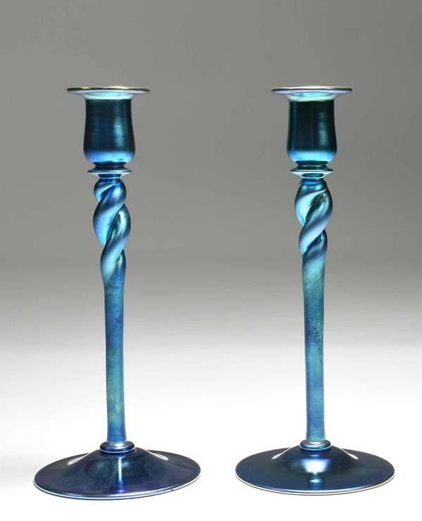 "Pair of blue Steuben Aurene candlesticks with spiral twist columns, inscribed on bottom ""Aurene 686"". 12""H x 5"" dia. 2 lbs. Condition: excellent, no chips or cracks."