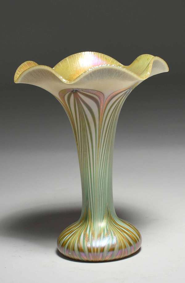 "Quezal ruffled edge art glass vase with gold interior and green, cream and gold exterior. Signed on bottom ""Quezal 897"". 7.25""H x 5.5"" dia. 1 lb. Condition: no chips cracks, some wear/scuffing to gold on edges of base, scuffing to bottom"