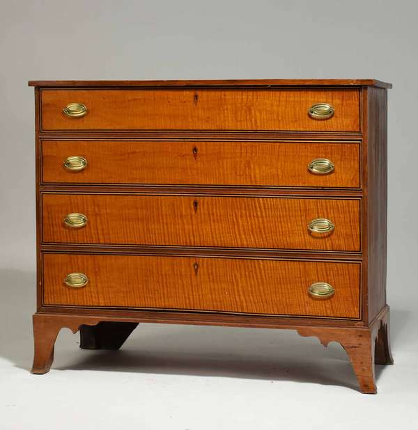 "Federal birch and tiger maple four-drawer chest on flared French feet, ca. 1810. 36.5""H x 40.5""W x 18""D. Condition: old refinish, brass replaced, structurally sound."