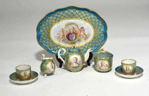 "Six-piece Sevres bleu céleste tea set, with painted portrait cartouches of Louis XV and important members of his court, including Madame du pompadour, Marie Leszczy?ska, Madame du Barry, Madame du Baraberie. With gilded decoration on a bleu céleste background. Titled and marked with crossed L's on bottoms. Tray 13.5"" x 10"", teapot 5""H, sugar 4""H, footed creamer 3.5""H, with two teacups and saucers. 5.5 lbs. total. Condition: 1/2"" chip to teapot lid inside. Some missing red and white enamel dots. Light wear to gilding on lids."