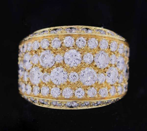 Eighteen karat yellow gold diamond cigar band pave set with approximately 4.0 ct. tw. round brilliant cut diamonds, F-G color, VS clarity, excellent cut. Ring size 6 ¾. 13.1 grams. Condition: very good