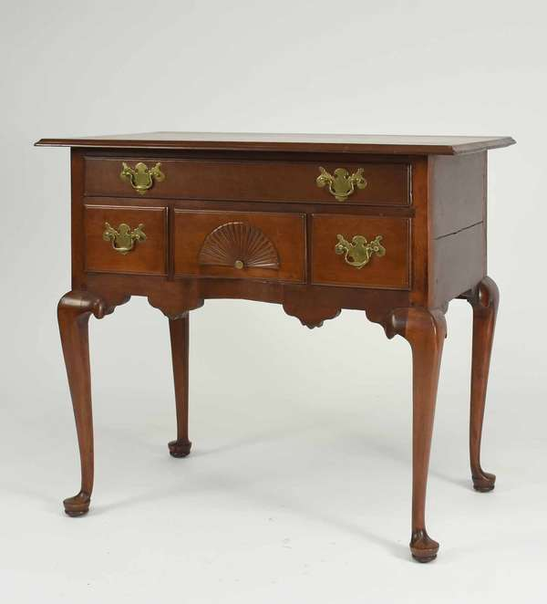 "18th C. Queen Anne CT cherry lowboy, with fan carving on center drawer, thumb molded top edge, and a single board top. Ca. 1760-1780.  A fine example of an 18th C. CT dressing table. 30""W x 30.5""H x 20.25""D. Condition: original top, likely off at some point, old brasses in original holes. Old refinish. No indication of ever having drop finials."