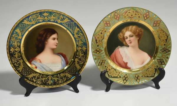 "Two 19th C. Royal Vienna cabinet plates; portrait of ""Elisabeth, Kaiserin van Oesterreich"" (Empress Elizabeth of Austria), signed Wagner, with a metallic blue and gold border. Titled and stamped on bottom. 9.5""dia. Other example with portrait of girl in pink, titled ""Sweet Marie."", with a light green, metallic green and gold geometric and floral border, signed Wagner, beehive mark and title on bottom. 9.5"" dia. 2.2 lbs total. Condition: very good, no chips or cracks. ""Elisabeth"" with light wear to border gilding."