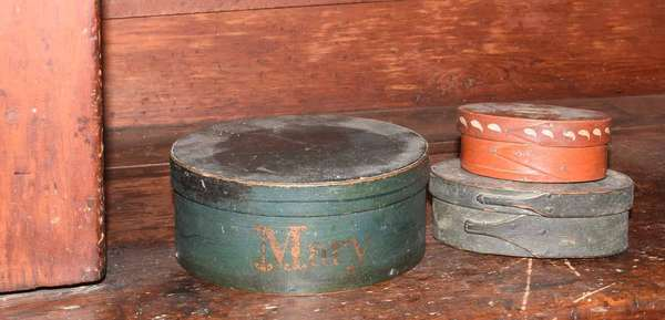 Three covered country boxes, including a pantry box in old green with