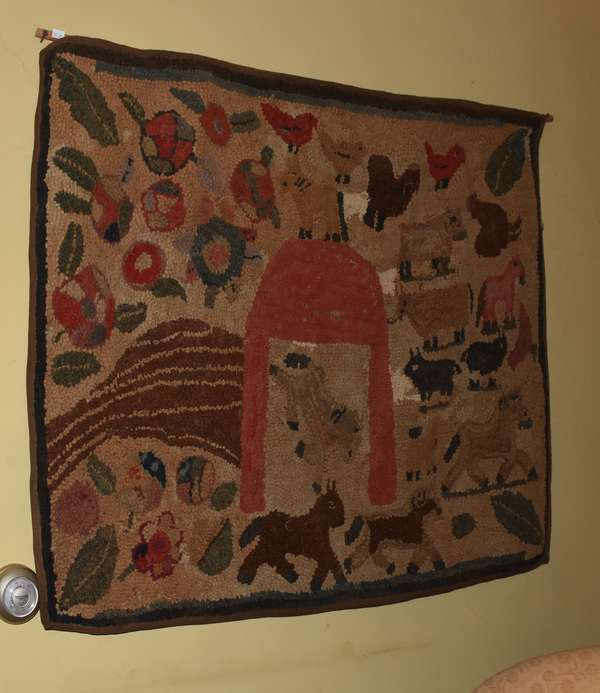 "19th C. folk art hooked rug, farm with animals & barn, with burlap backing, rings for hanging, and cloth edges. 33"" x 42"". Condition: some repair work throughout."