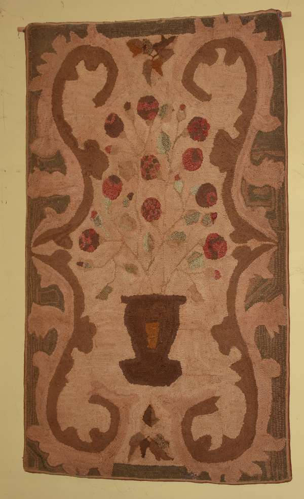 "19th C. hooked rug, pot of flowers, with rod attached at top for hanging. 49"" x 30"". Condition: overall good"