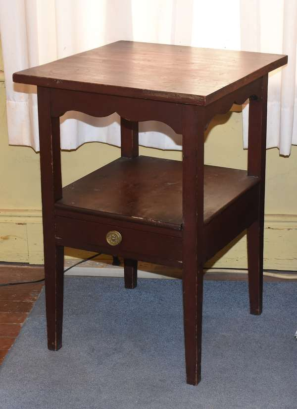 "New Hampshire school Federal cherry two-tier stand with one dovetailed drawer on lower gallery, and shaped apron above, original finish, 25.5""H. x 16.5""W x 16.5""L. Condition: overall wear, finish wear to legs"