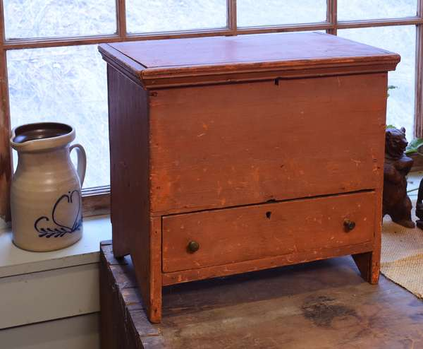 "19th C. child's lift-top blanket box with one drawer in early salmon paint, with keyholes and lid with molded edge. 14""W. x 13.5""H. x 9.5""D. Condition: a few expected abrasions and slight scratching along feet, commensurate with age."