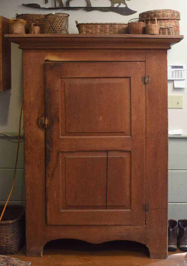 "Late 18th/early 19th C. floor cupboard with large molded top, and a full-length raised paneled door, on a cut-out base. Sides in an old blue-green paint, front with paint removed. 39.5""W. x 66.5""H. x 18""D. Condition: expected surface wear, paint wear, shrinkage crack in lower panel of door, 16.5"" section of molding on front right has been reattached."