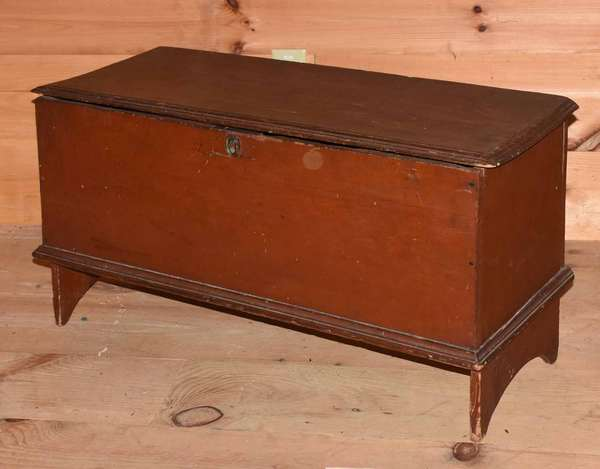 "18th C. Queen Anne New England blanket box, in old red paint, on half-moon cut-out base. With molded top and bottom. 35""L. x 20""H. x 14""D. Condition: slight warping to lid, some losses to edge of lid and box, wear to feet, losses to front top edge of box."