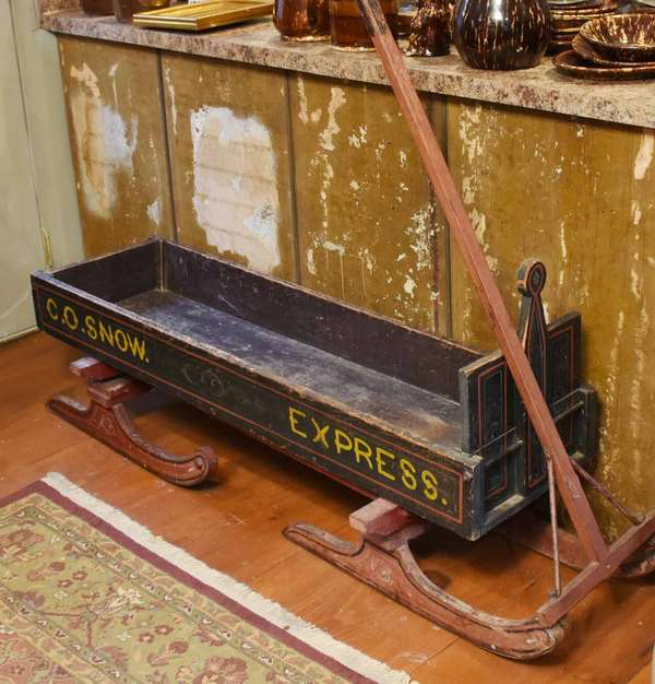 "19th C. paint decorated pull sleigh for grocery delivery, green and red designs with yellow lettering ""C.O. Snow Express"", on a black ground. Metal rod support on one side. 66""L. x 14.5""W x 27""H. Handle 49""L. Prov.-  Country store delivery sled from Wilmington, VT.  Circa 1880. Condition: paint wear to interior, surface scratches, structurally sound."