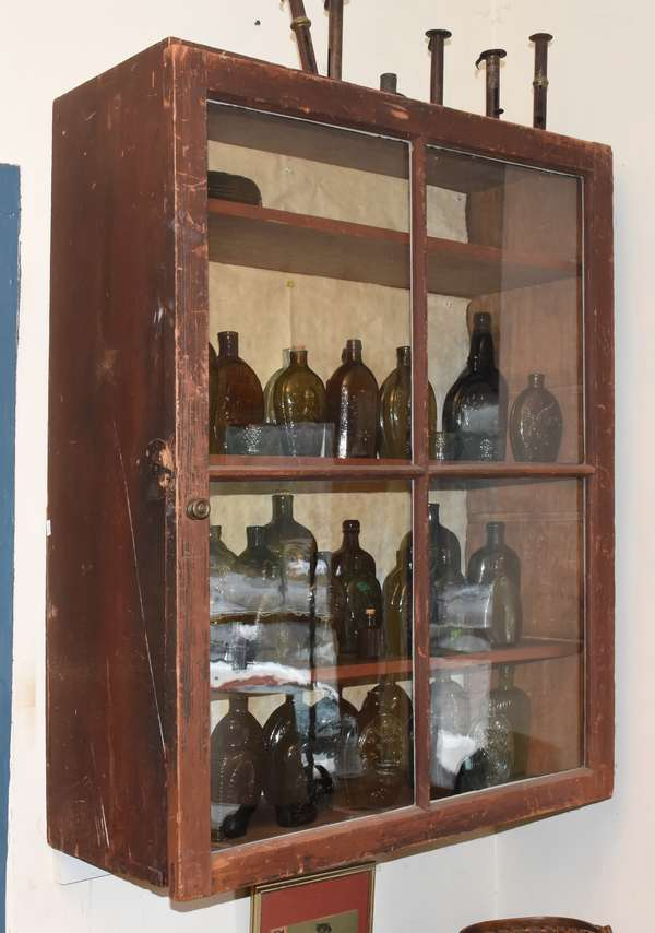 "Early country single glass door hanging cupboard, in old natural finish, 40""H. x 32""W. x 13""D. Condition: damage to lower left in rear, surface abrasions."