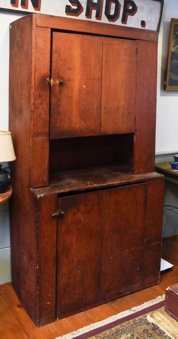 "Early 19th C. country pine set-back cupboard, in an old stain, with one door above and one below, 75""H. x 40""W. x 20""D. Condition: shrinkage cracks, minor nicks, abrasions, left side front facing below top door loose"