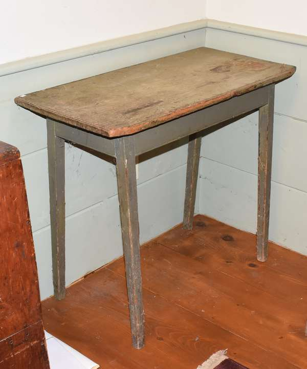 "19th C. country tapered leg work table in old gray paint, single board top with cut front corners. 31""H. x 36""L. x 18""D. Condition: overall wear and paint loss. Some shrinkage cracks to top"