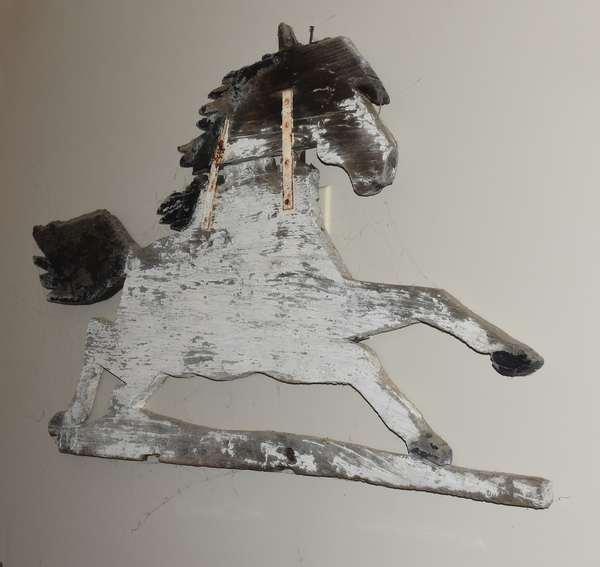 "Country wooden horse weathervane, painted white and black, 24""H. x 43""L. Condition: metal strap repairs, weather wear"