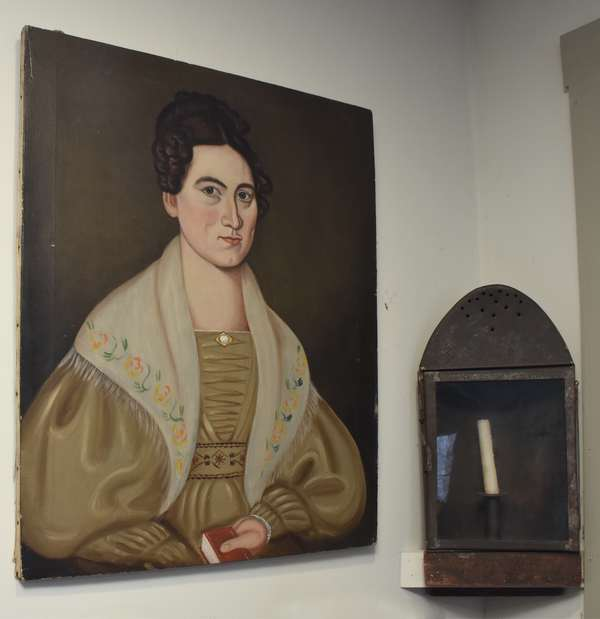 "Early 19th C. oil on canvas, folk art portrait of a young woman holding a book, found in Springfield VT, 28"" x 23"". Condition: good original canvas, no inpaint, attic found."