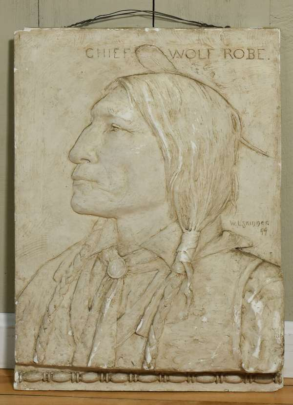 "Plaster relief plaque, Chief Wolf Robe by W.L. Skinner 1899, 23"" x 16"". Condition: scuffing throughout, chip to upper left corner, chips to top."