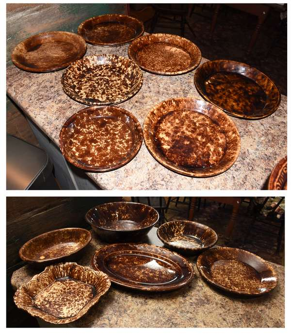 "Twelve pieces of Bennington style pottery including nine circular shallow bowls, 8""-12"" dia., oval platter 13""L., square bowl inspired serving dish, 8.5"" square, and oval dish, 10""L. Condition: chipping to edge of oval platter."