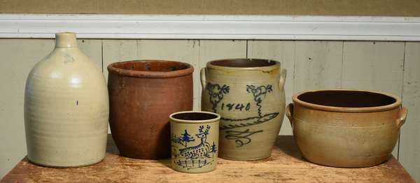 "Six stoneware crocks including a two gallon crock with cobalt decorated, dated 1840, 11""H; redware crock 10""H., 2 gallon stoneware jug, 14""H, crock 12"" dia, crock, 8""H. Condition: five chips to rim of 1840 crock, one chip to body, one to foot. Redware jug with wear."