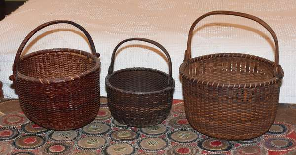 "Lot of three graduated Nantucket baskets, 6"", 8"" and 9"" Dia. Condition: losses to body on largest basket, stain wear on all."