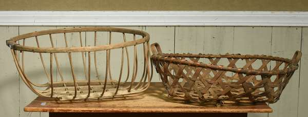 "Large early two handled tobacco drying basket, 24""W x 27.5""L with other herb drying wooden basket, 26""D. Condition: some breaks to bottom edge of tobacco basket, loss to one bottom corner on herb basket"