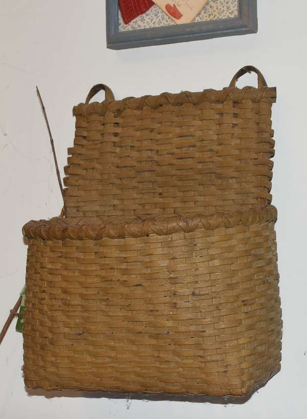 "20th C. wall basket in old mustard paint, 15""H. x 13""W. x 8""D. Condition: some cracking to paint and minimal loss to paint. No breakages."