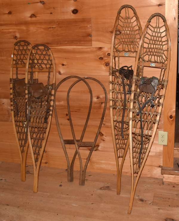 "Two pairs of snow shoes, one by Tubbs VT, 10"" x 46"" - S3, with leather strapping; a pair of Snocraft, Maine snowshoes with rawhide and  leather Snowshoes. strapping, 10"" x 56"", along with a pair of Native American style snow shoe frames, 13"" x 35"". Condition: very good, leather feet binds on Snocraft stiff."