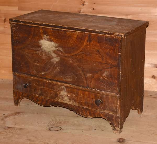 "Early 19th C. one-drawer grain painted blanket chest with cut-out base, VT origin, dovetailed drawer construction, 34""W. x 27""H. x 15""D. Condition: finish loss to front facing and front of drawer, scratches to top."