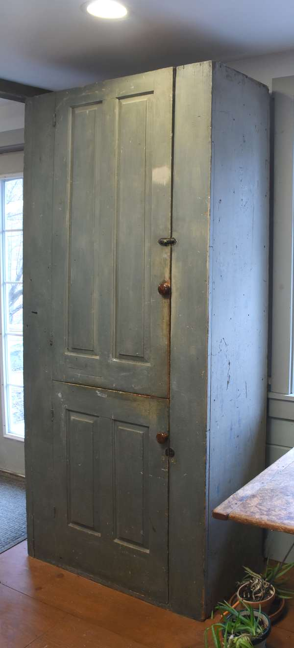 "18th C. gray painted two-door floor cupboard, with Bennington style pottery knobs, gray over early blue/gray paint. Interior with shelves. 85""H. x 39""W. x 16""D., Condition: right side with different grey paint color. Front spattered with black paint. Expected surface abrasions and nicks"