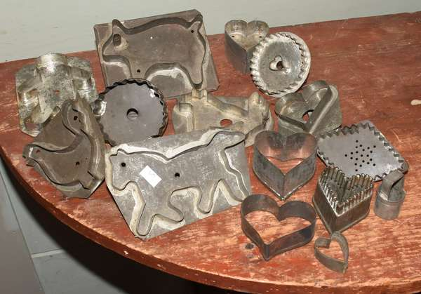 "Fourteen antique tin cookie cutters with basket, including chicken, horse, dog, etc. 1""-5""L. Condition: some with rusting."