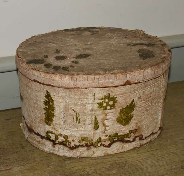 "19th C. wallpaper hat box, newspaper on bottom from Poultney Vermont, dated 1927. Green and white floral and Classical motifs. 12.5""L x 10.5""W x 7""H. Condition: water staining to bottom and bottom edges. Some wallpaper losses to lid."