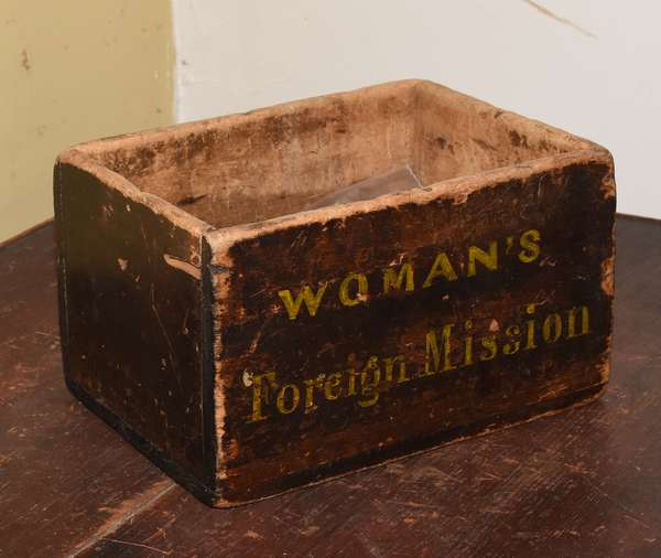 "Small 19th C. storage box, in old stain with writing in yellow reading, ""Woman's Foreign Mission."" 8""L x 5.75""W x 5""H. Condition: paint wear to edge and interior, lightly on outside"