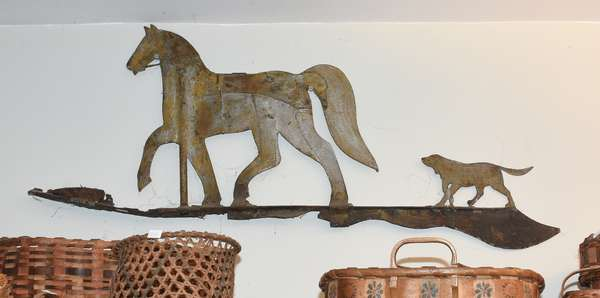 "Tin horse and dog weathervane, 36""L. x 14""H. Condition: horse reinforced with more tin, rusting and wear."