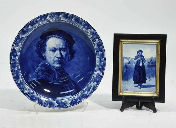 """Delft porcelain charger of Rembrandt artist signed 16""""D with a Delft framed tile, girl and goat, 8"""" X 6"""". Condition charger in good condition no chips or cracks, tile has some crazing."""
